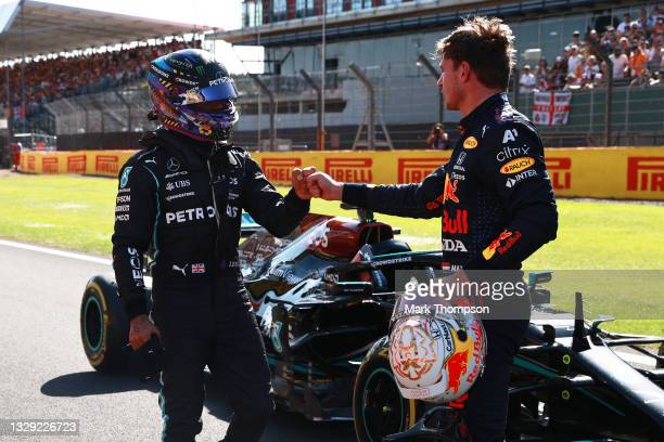 Winner Max Verstappen of Netherlands and Red Bull Racing and second placed Lewis Hamilton of Great Britain and Mercedes GP bump fists in parc ferme...