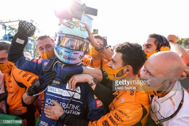 Winner McLaren's Australian driver Daniel Ricciardo celebrates with his team after the Italian Formula One Grand Prix at the Autodromo Nazionale...
