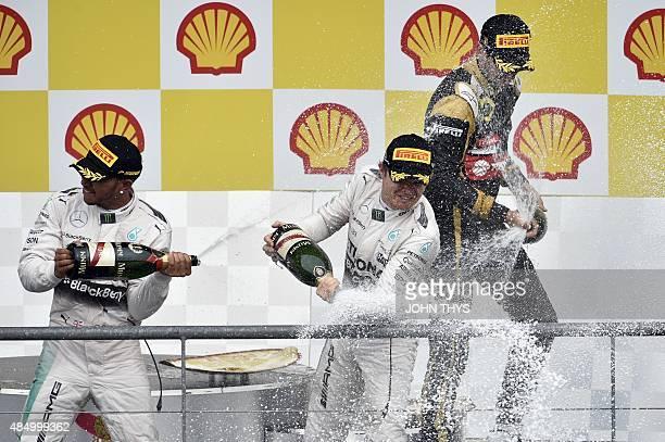 Winner Mercedes AMG Petronas F1 Team's British driver Lewis Hamilton , second placed Mercedes AMG Petronas F1 Team's German driver Nico Rosberg and...