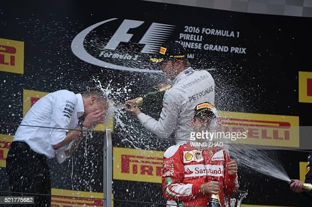 Winner Mercedes AMG Petronas F1 Team's German driver Nico Rosberg and second-placed Ferrari's German driver Sebastian Vettel celebrate on the podium...
