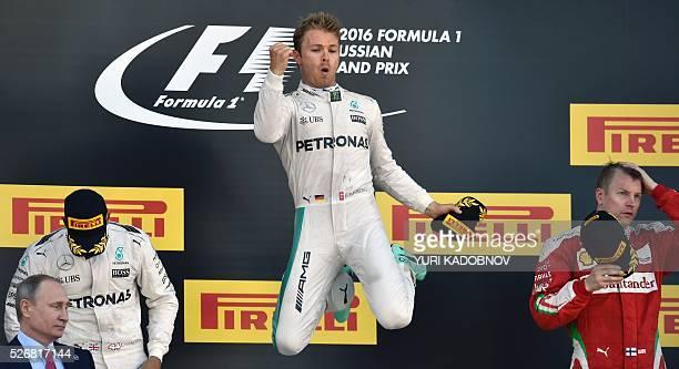 TOPSHOT Winner Mercedes AMG Petronas F1 Team's German driver Nico Rosberg celebrates on the podium next to second placed Mercedes AMG Petronas F1...
