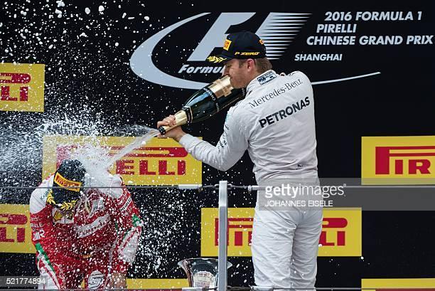 Winner Mercedes AMG Petronas F1 Team's German driver Nico Rosberg celebrates with second-placed Ferrari's German driver Sebastian Vettel on the...
