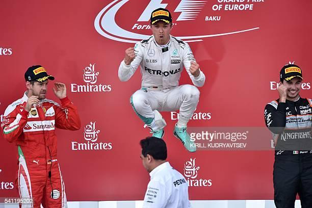 Winner Mercedes AMG Petronas F1 Team's German driver Nico Rosberg celebrates next to second placed Scuderia Ferrari's German driver Sebastian Vettel...
