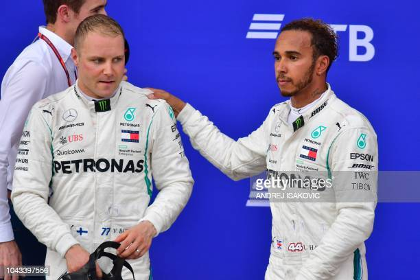 Winner Mercedes' British driver Lewis Hamilton and second placed Mercedes' Finnish driver Valtteri Bottas after finishing in the Formula One Russian...