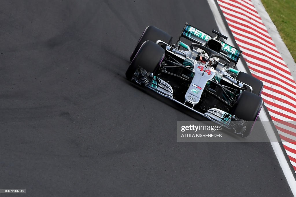TOPSHOT - Winner Mercedes' British driver Lewis Hamilton steers his car during the Formula One Hungarian Grand Prix at the Hungaroring circuit in Mogyorod near Budapest, Hungary, on July 29, 2018.