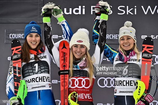 Winner Mikaela Shiffrin of the US celebrates on the podium with secondplaced Slovakia's Petra Vlhova and thirdplaced Sweden's Frida Hansdotter after...