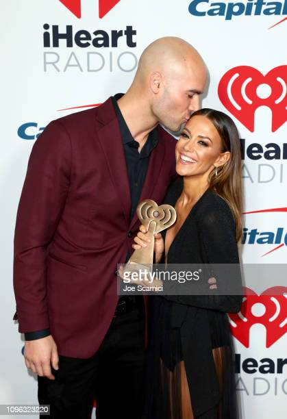 Winner Mike Caussin and Jana Kramer pose in the press room at the 2019 iHeartRadio Podcast Awards Presented by Capital One at the iHeartRadio Theater...