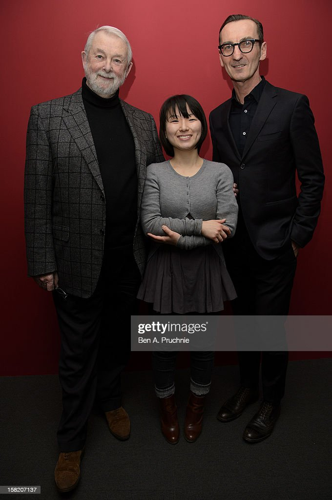 Winner Min Kyung Song (C) poses photographs with judge Colin McDowell (L) and Bruno Frisoni (R) at the Fashion Fringe and Accessories 2012 award at IMG Fashion, on December 11, 2012 in London, England.