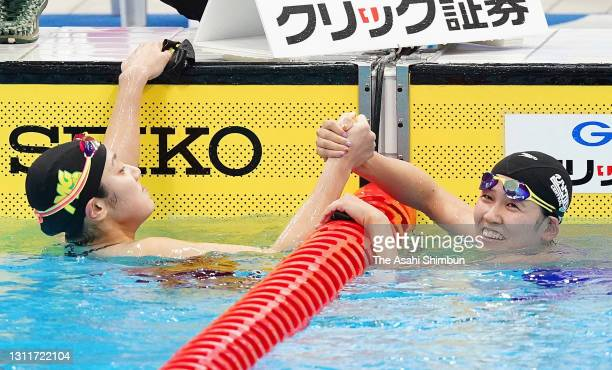Winner Miyu Namba and second place Waka Kobori shake hands after competing in the Women's 800m Freestyle final on day seven of the 97th Japan...