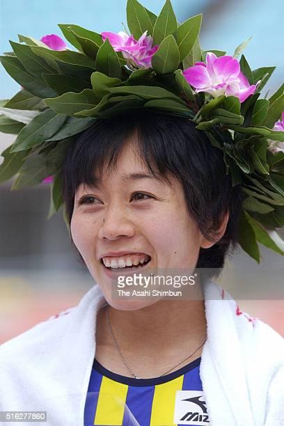 Winner Mizuki Noguchi of Japan celebrates at the medal ceremony after the 22nd Osaka Women's Marathon at the Nagai Stadium on January 26 2003 in...