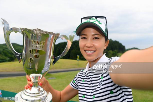 Winner Momoko Ueda of Japan imitates a selfie after the award ceremony following the final round of the Yonex Ladies Golf Tournament at Yonex Country...