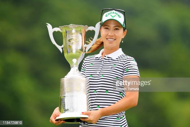 Winner Momoko Ueda of Japan poses with the trophy after the award ceremony following the final round of the Yonex Ladies Golf Tournament at Yonex...