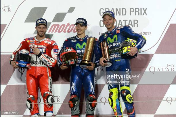 Winner Movistar Yamaha MotoGP's racer Maverick Vinales his teammate and runner up Valentino Rossi and third place finisher Ducati Team's Italian...