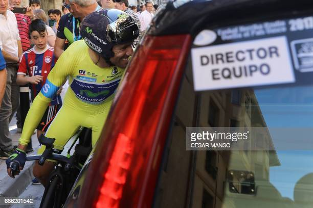 Winner Movistar's Spanish rider Alejandro Valverde greets his team manager on April 8 2017 after the last day of the 2017 Tour of the Basque country...