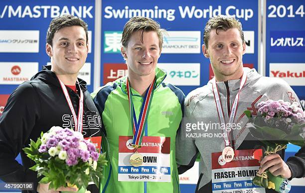 Winner Myles Brown of South Africa second place James Guy of Gritain and third place Thomas FraserHolmes of Australia celebrate on the podium during...