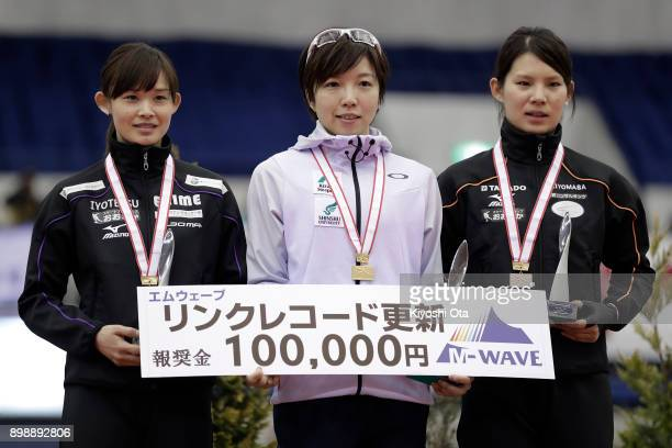 Winner Nao Kodaira celebrates with runnerup Arisa Go and thirdplaced Erina Kamiya at the award ceremony for the Ladies' 500m competition during day...