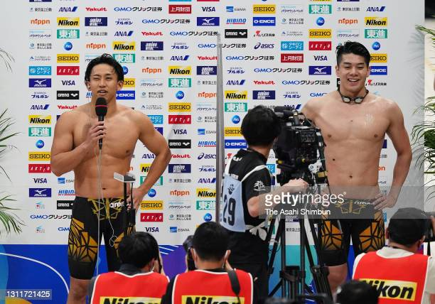 Winner Naoki Mizunuma and second place Takeshi Kawamoto are interviewed after competing the Men's 100m Butterfly final on day seven of the 97th Japan...