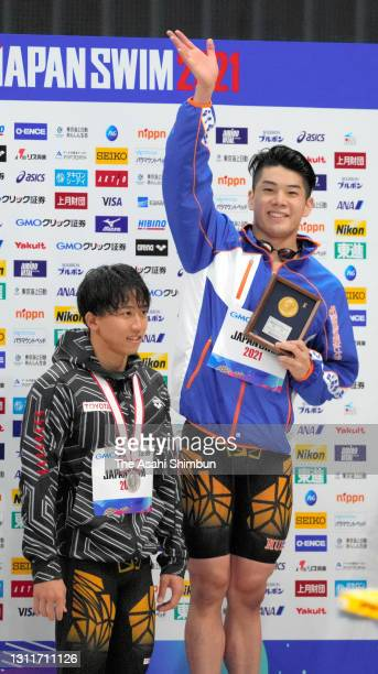 Winner Naoki Mizunuma and second place Takeshi Kawamoto are seen on the podium at the medal ceremony for the Men's 100m Butterfly final on day seven...