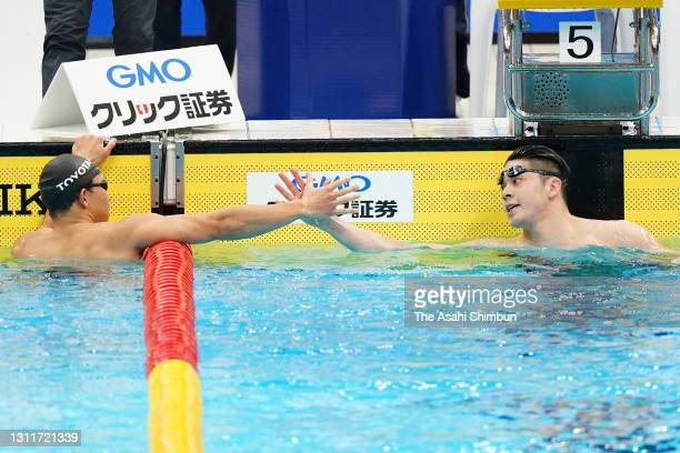 Winner Naoki Mizunuma and second place Takeshi Kawamoto celebrate as they qualified for the Tokyo Olympics after competing in the Men's 100m...