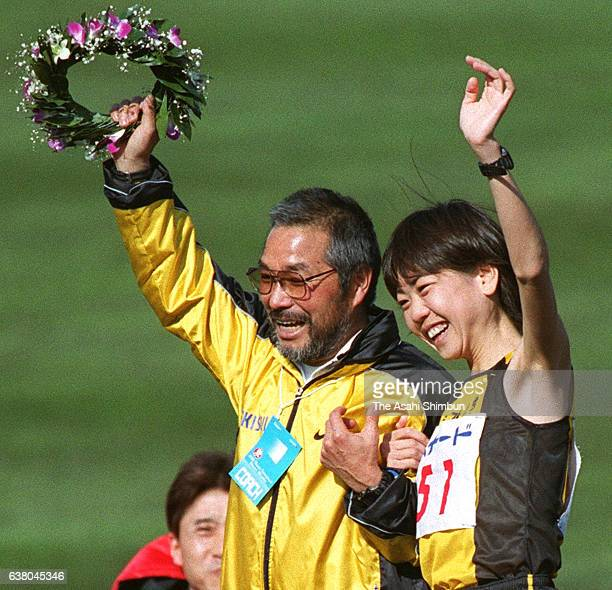 Winner Naoko Takahashi of Japan celebrates with her coach Yoshio Kiode after the 21st Nagoya International Women's Marathon at Mizuho Stadium on...
