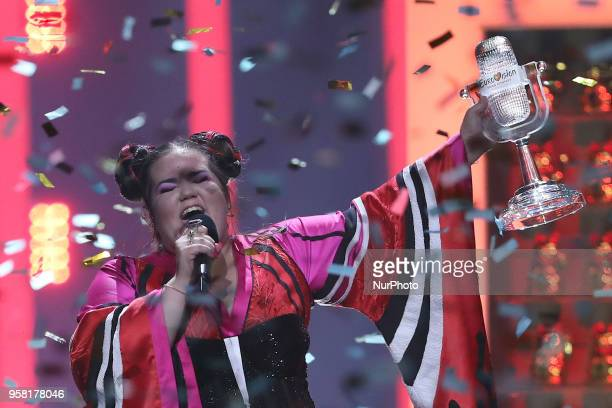 Winner Netta of Israel performs with the trophy during the 2018 Eurovision Song Contest Grand Final at the Altice Arena in Lisbon Portugal on May 12...