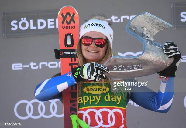 TOPSHOT Winner New Zealand's Alice Robinson poses on the podium of the Women's giant slalom at the FIS ski World cup on October 26 2019 in Soelden...