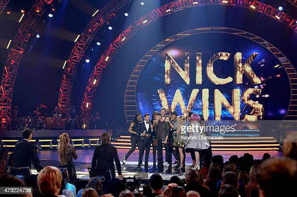 """Winner Nick Fradiani onstage with host Ryan Seacrest and American Idol finalists during """"American Idol"""" XIV Grand Finale at Dolby Theatre on May 13,..."""
