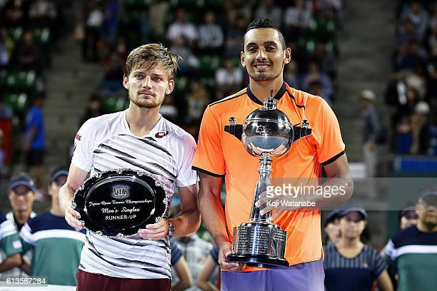 Winner Nick Kyrgios of Australia and runnerup David Goffin of Belgium pose for photographs after men's singles final match against on day seven of...
