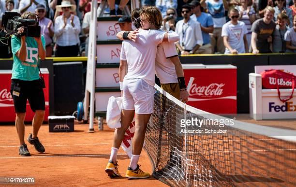 Winner Nikoloz Basilashvili of Georgia hugs Andrey Rublev of Russia during the Hamburg Open 2019 at Rothenbaum on July 28 2019 in Hamburg Germany