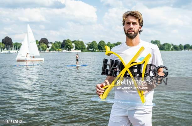 Winner Nikoloz Basilashvili of Georgia poses with the trophy during the Hamburg Open 2019 at Rothenbaum on July 28 2019 in Hamburg Germany