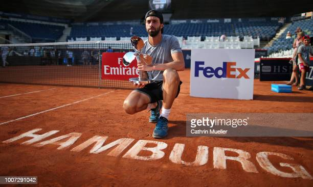 Winner Nikoloz Basilashvili of Georgia with his trophy after his Final against Leonardo Mayer of Argentina during the German Tennis Championships at...