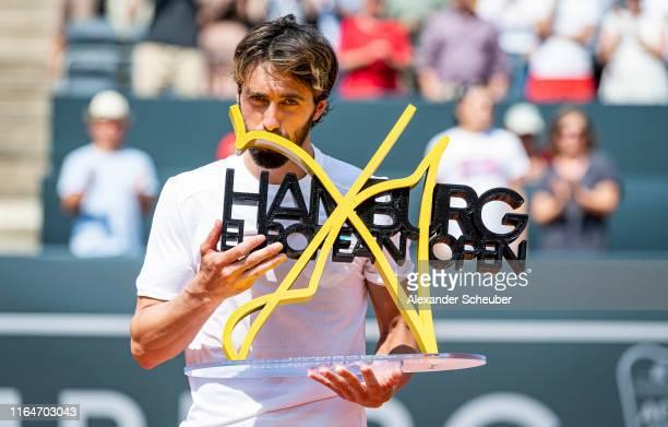 Winner Nikoloz Basilashvili of Gerogia celebrates winning the Hamburg European Open 2019 at Rothenbaum on July 28 2019 in Hamburg Germany