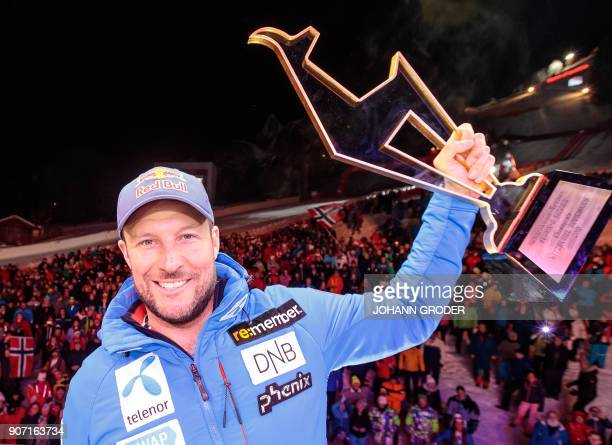 Winner Norway's Aksel Lund Svindal poses with his trophy during the winner ceremony of the Mens SuperG event at the FIS Alpine World Cup on January...