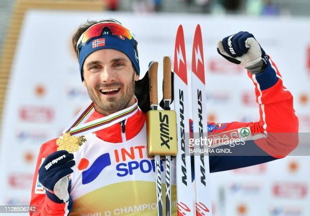 Winner Norway's Hans Christer Holund poses with his medal after the CrossCountry Men 50km Mass Start Free event at the FIS Nordic World Ski...