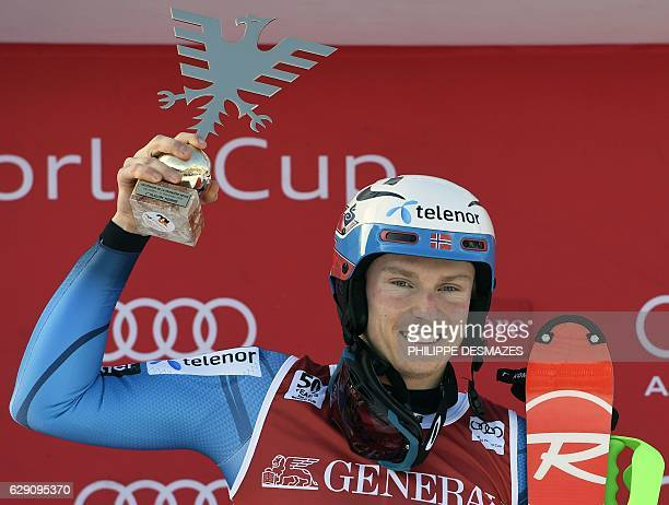 Winner Norway's Henrik Kristoffersen holds his trophy as he celebrate on the podium after the FIS Alpine World Cup Men's Slalom in Val d'Isere in the...