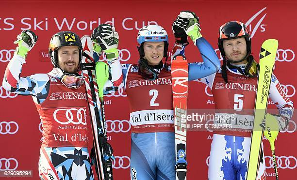 Winner Norway's Henrik Kristoffersen second placed Austria's Marcel Hirscher and third placed Russia's Alexander Khoroshilov celebrate on the podium...
