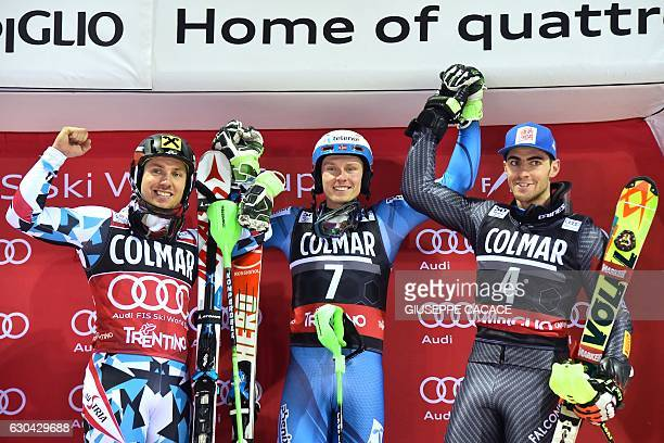 Winner Norway's Henrik Kristoffersen secondplaced Austria's Marcel Hirscher and thirdplaced Italy's Stefano Gross celebrate on the podium of the...