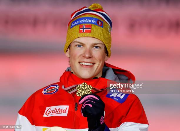 Winner Norway's Johannes Hosflot Klaebo poses with his medal during the medal ceremony of the men's classic sprint event at the FIS Nordic Ski World...