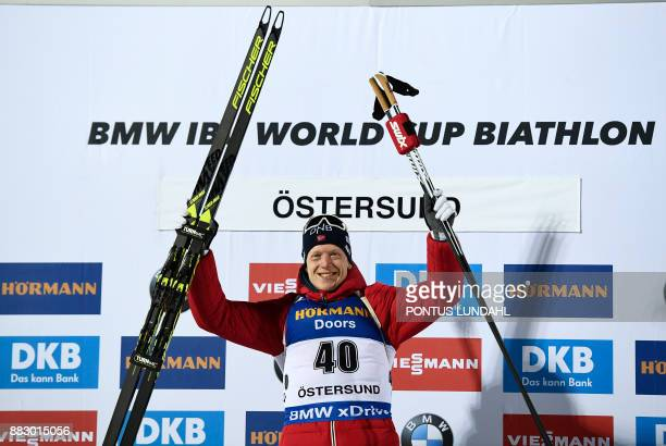 Winner Norway's Johannes Thingnes Boe celebrates after the men 20 km individual event at the IBU World Cup Biathlon in Ostersund, Sweden, on November...