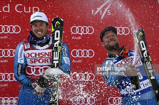 Winner Norway's Kjetil Jansrud and second placed Norway's Aksel Lund Svindal spray champagne as they celebrate on the podium after competing in the...