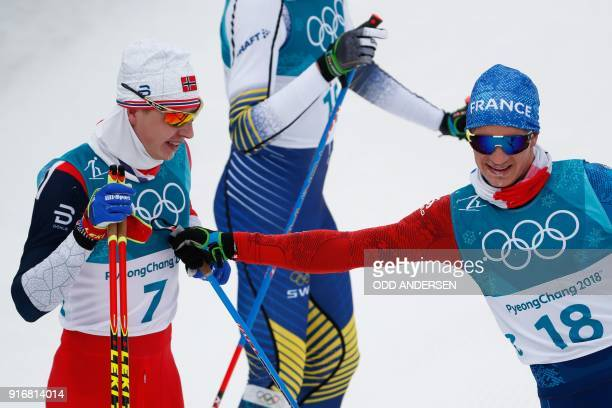 Winner Norway's Simen Hegstad Krueger is congratulated by France's Clement Parisse at the end of the men's 15km 15km crosscountry skiathlon at the...