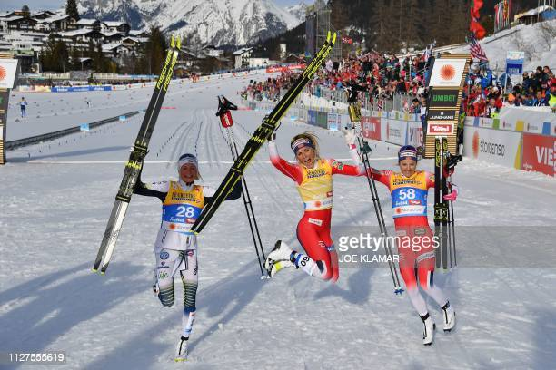 Winner Norway's Therese Johaug second placed Sweden's Frida Karlsson and third placed Norway's Ingvild Flugstad Oestberg react after the Ladies' 10km...