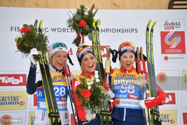 Winner Norway's Therese Johaug second placed Sweden's Frida Karlsson and third placed Norway's Ingvild Flugstad Oestberg celebrate on the podium...