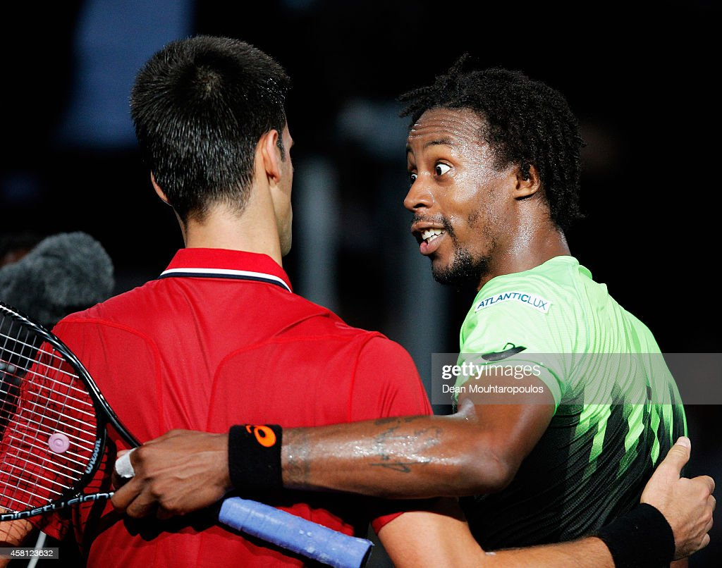 Winner, Novak Djokovic (L) of Serbia and Gael Monfils of France embrace after their match during day 4 of the BNP Paribas Masters held at the at Palais Omnisports de Bercy on October 30, 2014 in Paris, France.