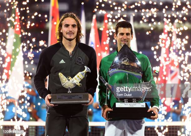 Winner Novak Djokovic of Serbia and runner up Stefanos Tsitsipas of Greece celebrate with the trophies after their men's final match on Day 13 of the...
