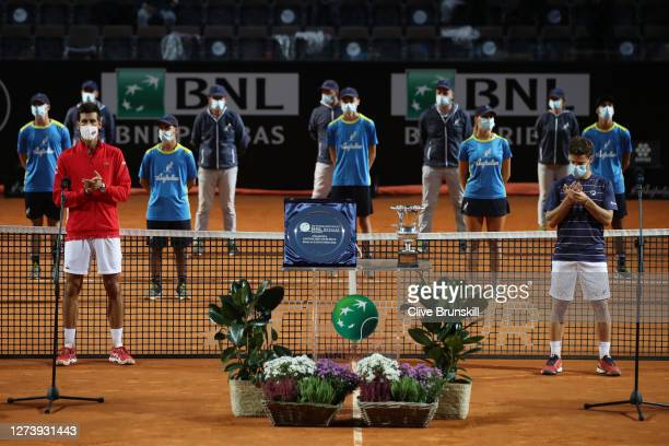 Winner Novak Djokovic of Serbia and runner-up Diego Schwartzman of Argentina stand for the presentation ceremony after their men's final match during...