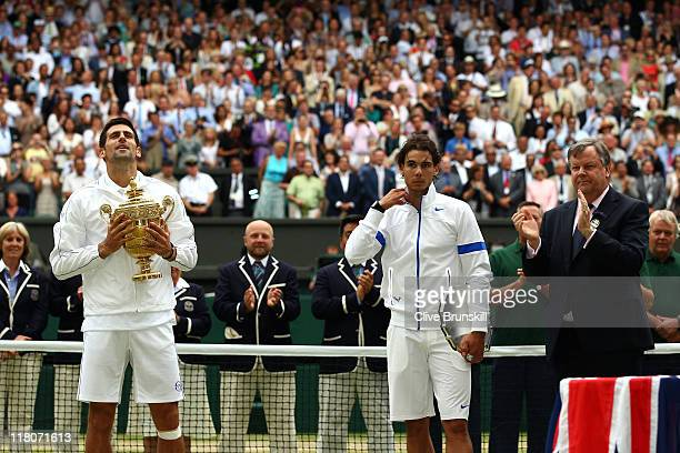 Winner Novak Djokovic of Serbia and runnerup Rafael Nadal of Spain with their trophies after their final round Gentlemen's match on Day Thirteen of...