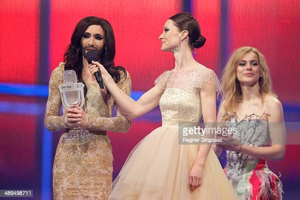 Winner of 2014 Eurovision Song Contest Conchita Wurst of Austria hostess Lise Ronne and the winner of Eurovision Song Contest 2013 Emmelie de Forest...