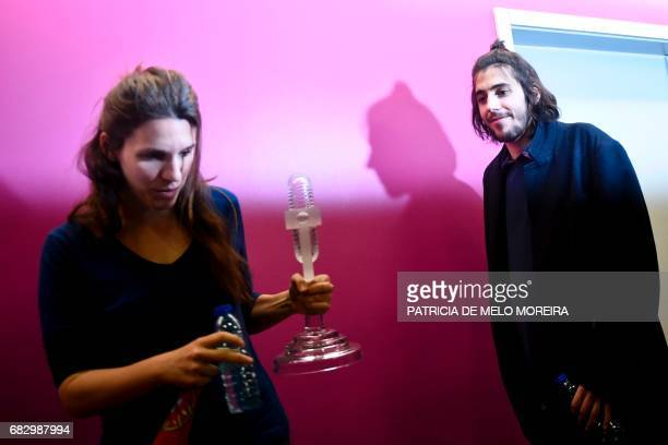 Winner of 2017 Eurovision contest Salvador Sobral accompanied by his sister Luisa Sobral stand before a press conference upon their arrival at...