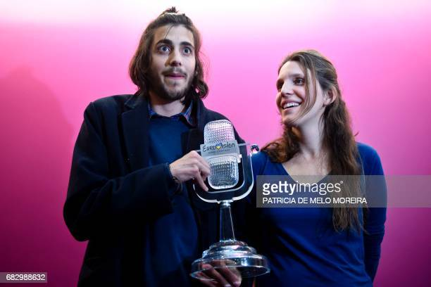 Winner of 2017 Eurovision contest Salvador Sobral accompanied by his sister Luisa Sobral poses with his trophy before a press conference upon their...